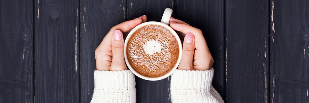 Hands holding a cup of coffee - Dairy and Ice cream - AAK