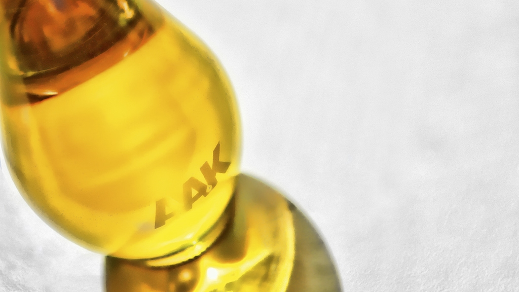 Close-up of olive oil bottle with AAK logo - Special Nutrition - AAK