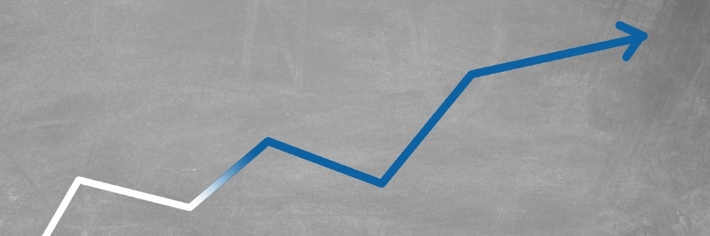 Graph Turning Into AAK Blue on a Blackboard Background - Investors - AAK