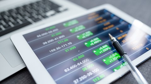 Close-up of tablet displaying financial graphs - Investors - AAK