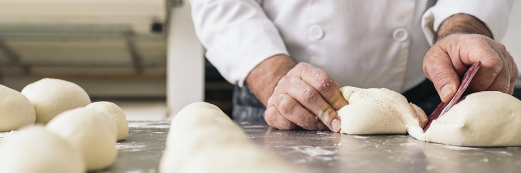 Baker Dividing Bread Dough Into Pieces - Bakery - AAK