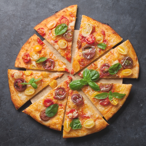 Delicious Pizza with Basil and Tomato on a Marble Table - Bakery - AAK