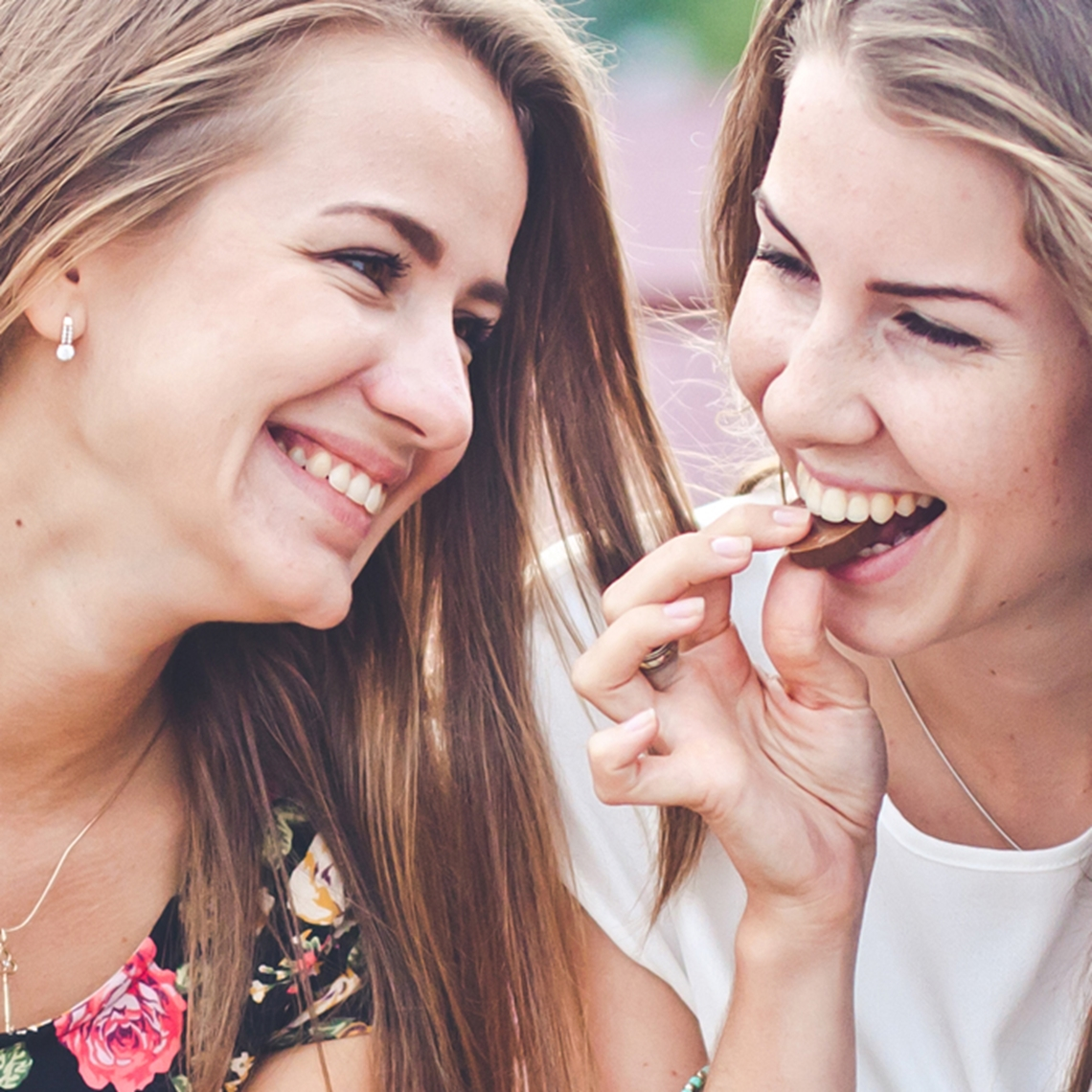 Smiling Women Eating Chocolate - Chocolate and Confectionery - AAK