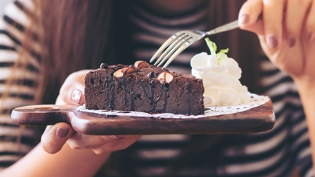 Chocolate cake and whipped cream on a plate - Applications - AAK