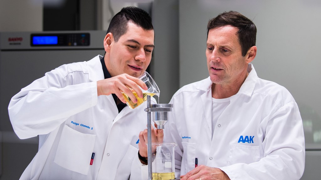 Two men wearing white coats in laboratory - Special Nutrition - AAK
