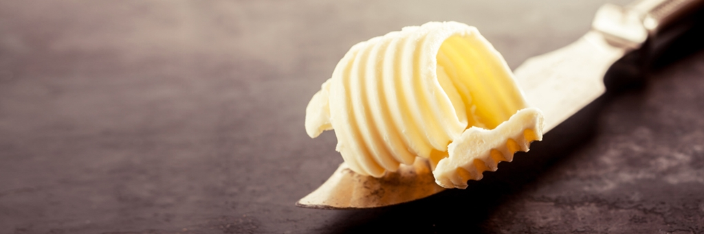 Close-up of butter on a knife - Foodservice and Retail - AAK