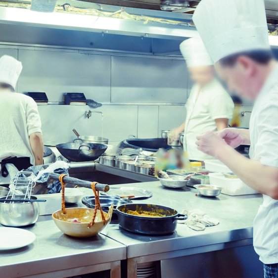 Busy Kitchen with Chefs Cooking Food - Foodservice and Retail - AAK