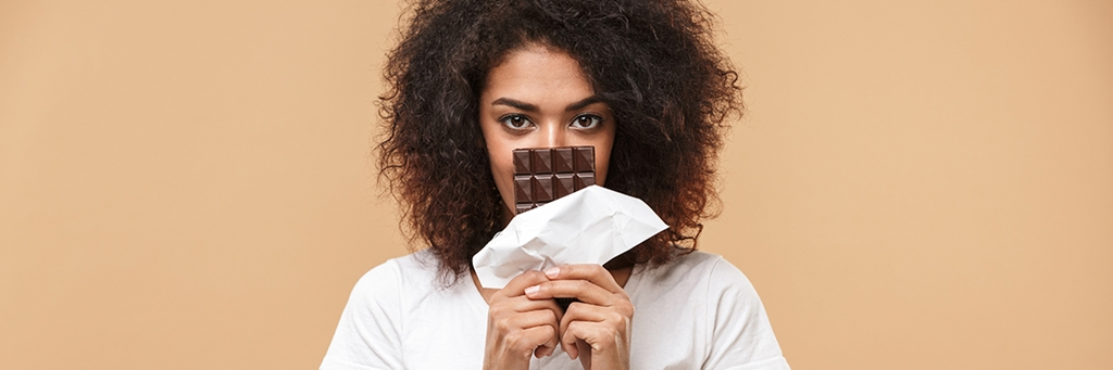 girl holding chocolate bar